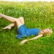 The beautiful happy girl lies in the field of camomiles — Stock Photo #4833516