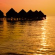 Maldives.Villa on piles on water at the time sunset. — Stock Photo