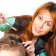 Pretty woman hairdresser cuts client — Stock Photo #4910314