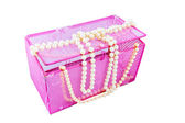 Pink casket and pearl beads on a white background — Stock Photo