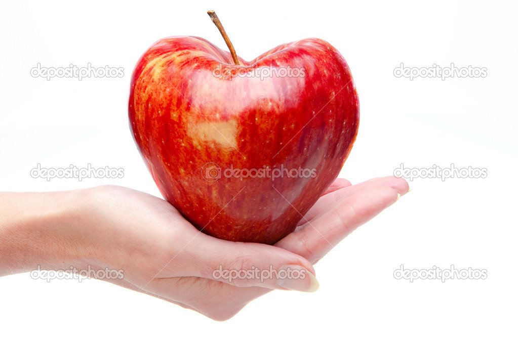 Hand with an apple in the form of heart  Stock Photo #4910334