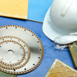 Stockfoto: Diamond discs for cutting of tile, goggles and helmet on tile