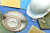 Diamond discs for cutting of tile, goggles and a helmet on a tile — Stock Photo