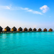 Maldives.Villa on piles on water at the time sunset. — Stock Photo #5076267