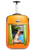 The girl in bikini looks out of a suitcase and invites to rest — Stock Photo