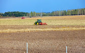 Tractor works in the field — Stock Photo