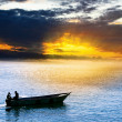 Silhouette of fisherman on the sea — Stock Photo