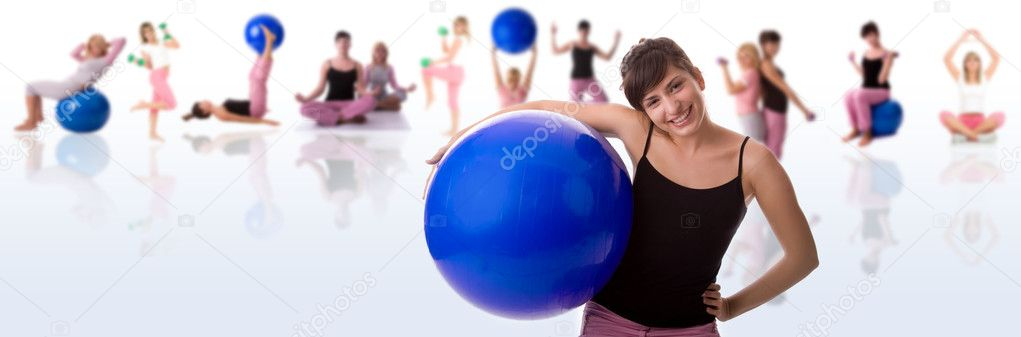 Fitness woman with team (blurred ) in background. — Stock Photo #3966242