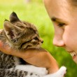 Stock Photo: Girl and kitten