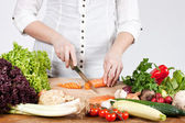 Chopping vegetable — Stock Photo