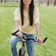 Royalty-Free Stock Photo: Young woman on bike outdoors
