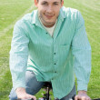 Young man on bike outdoors — Stock Photo #5318549