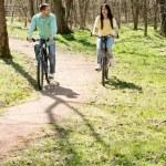 Couple on bike outdoors — Stock Photo