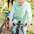 Stock Photo: Couple on bike