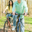 Couple on bike — Stock Photo