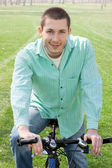 Young man on bike outdoors — Stock Photo