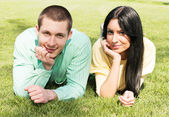 Young couple relaxing outdoors happiness — Stock Photo