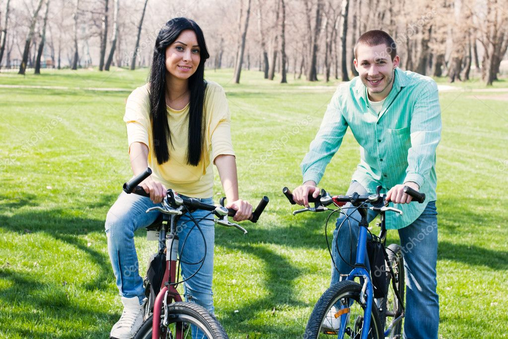 Couple on bike outdoors happiness.  Stock Photo #5318442