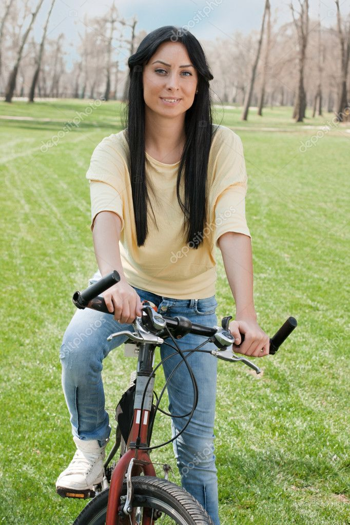 Young woman on bike relaxing outdoors. — Stock Photo #5318488