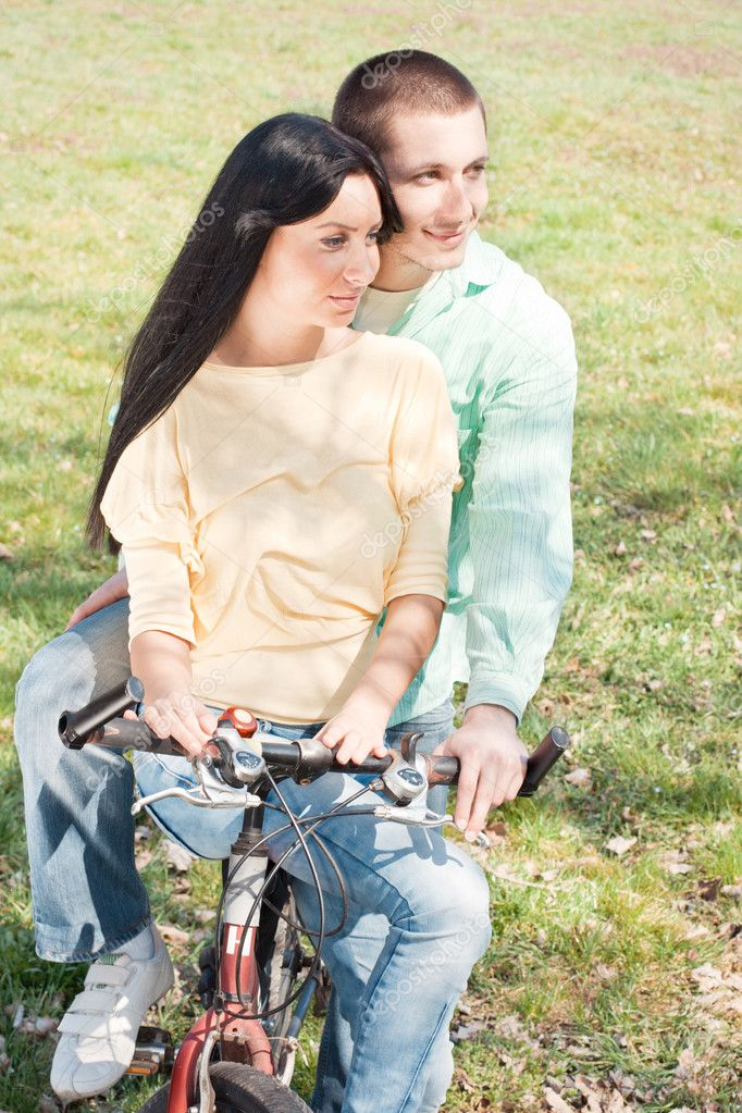 Loving couple on bike outdoors. — Stock Photo #5318736