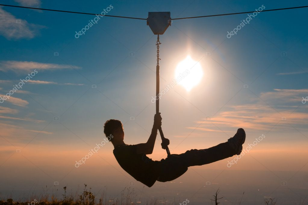 Silhouette of a boy playing with a tyrolean traverse — Stock Photo #3938487