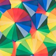 Umbrella with rainbow colors as background — ストック写真