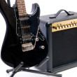 Electric guitar and amplifier isolated on a white background - Photo