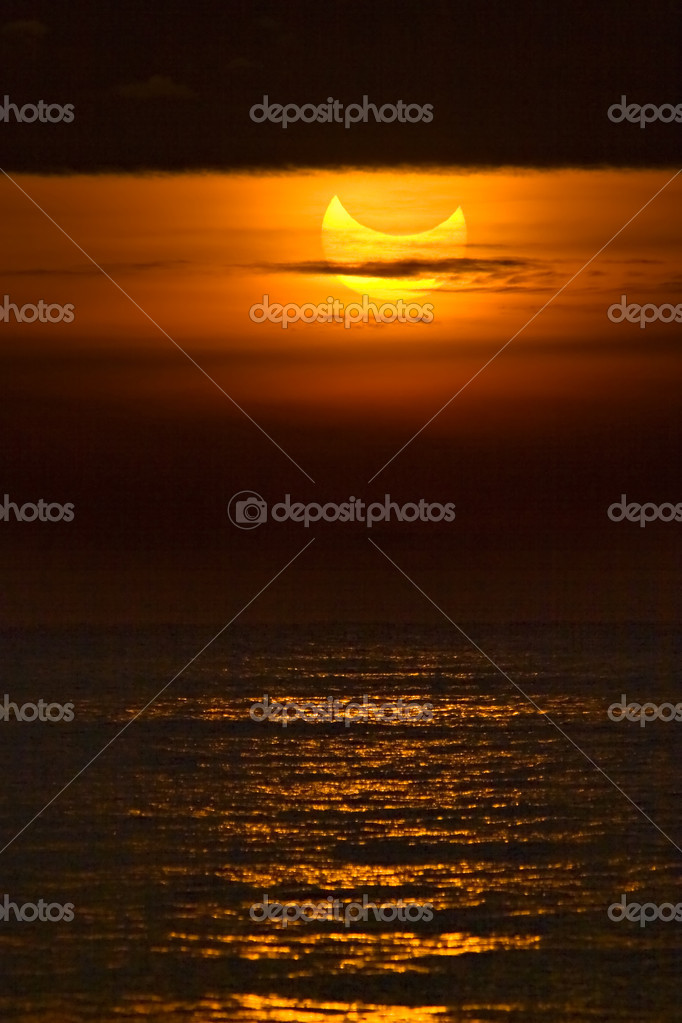 Catalonia - January 4: Partial solar eclipse during sunrise January 4, 2011 in Catalonia  Zdjcie stockowe #4614704