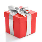 Single red gift box with gold ribbon on white background. — ストック写真