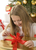 Happy little girl with christmas — Stock Photo