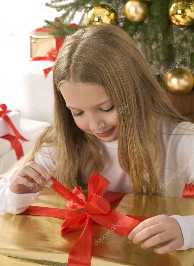 Happy little girl with christmas — Stock Photo #4170226