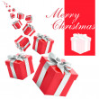 Red gift boxes with silver ribbon on white background. — Stock Photo