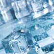 Stock Photo:  Ice cubes in blue ambient light. Good for background