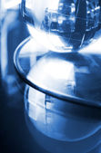 Globe made of glass in blue ambient light. — Stock Photo