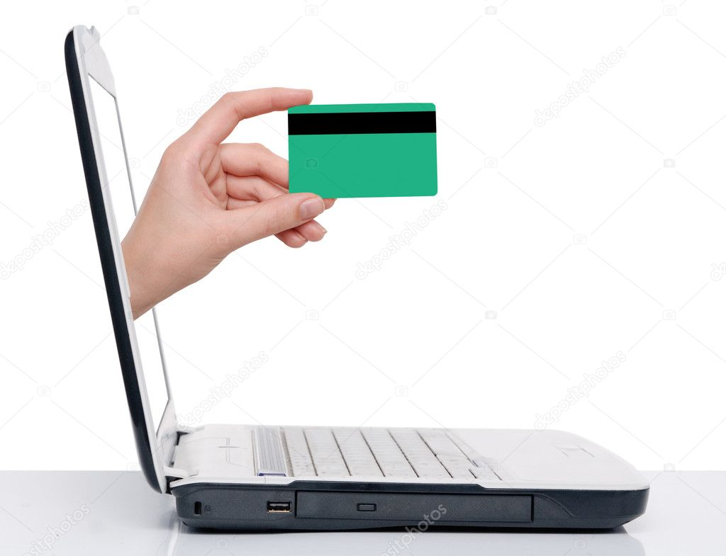 Hand with credit card comes from laptop screen  Stock Photo #4613629