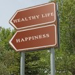 Stock Photo: Road sign to happiness and healthy life