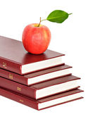Red apple on pile of books on white background — Stock Photo