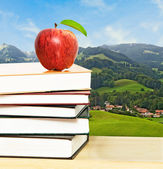 Apple with books — Stock Photo