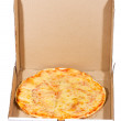 Pizza in open paper box — Stock Photo