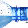 Plastic bottle with water drops — Stock Photo