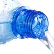 Water pouring down from plastic bottle — Stock Photo