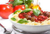 Pasta with meatballs and basil with tomato sauce — Stock Photo