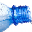 Water is pouring down from plastic bottle — Stock Photo