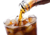 Cola is pouring into glass — Stock Photo