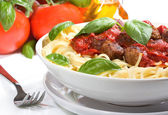 Pasta with meatballs and basil — Stock Photo
