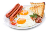 Fried eggs with bacon, sausages and toasts — Stock Photo
