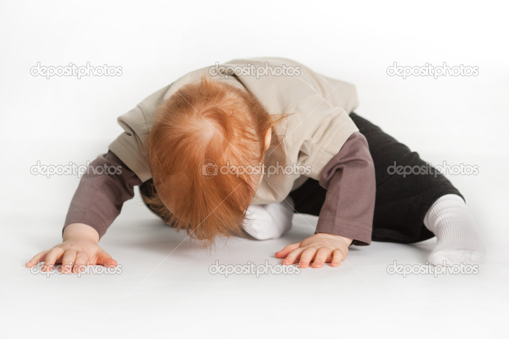 Small boy laying on a white floor. — Stock Photo #4589625
