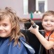 Children play in the barbershop - Stock Photo