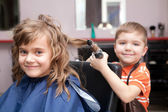 Children play in the barbershop — Stock Photo
