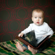 Little boy reading book at home — Stock Photo